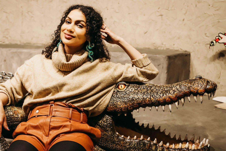 Woman sitting on a fake crocodile at Reptilia Zoo