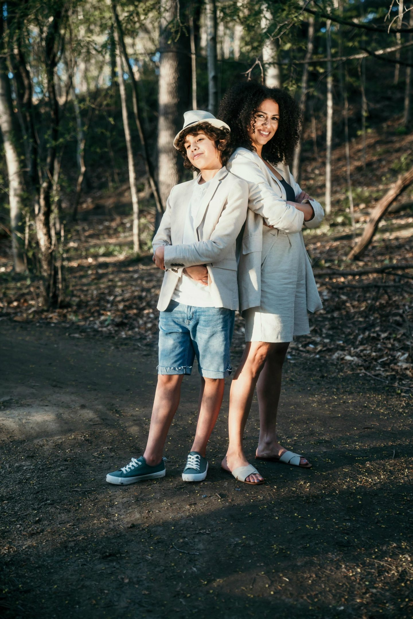 Mom and Special Needs son with Childhood Apraxia of Speech stating in the woods